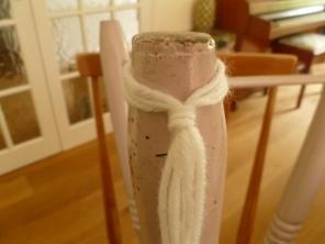 Hook over a stool leg or door knob